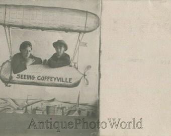 Two men on fake hot air balloon antique arcade photo pc