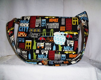Black and bright, travel inspired messenger style shoulder bag.
