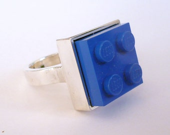 Handmade sterling silver ring with blue lego brick