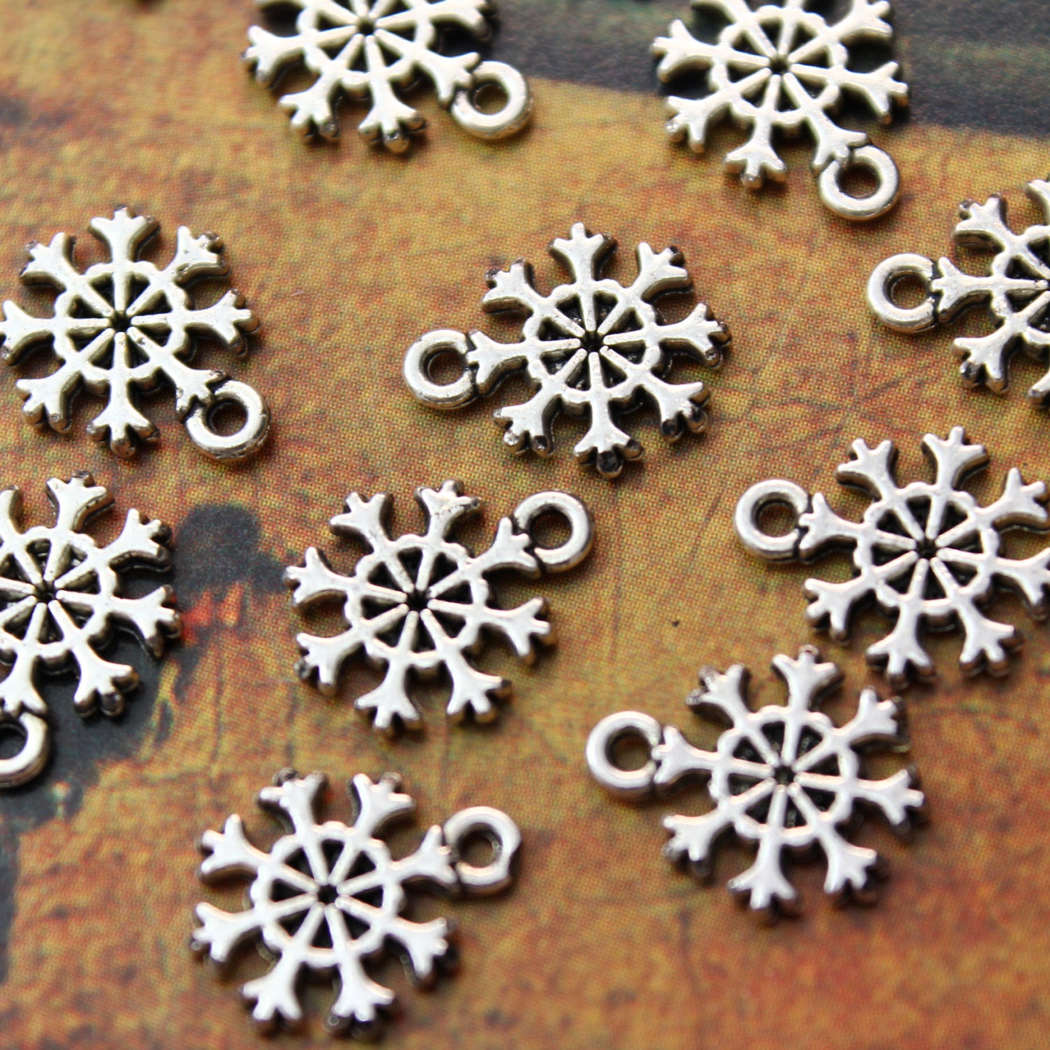 bulk 50 tiny snowflake charms snowflake pendants antiqued
