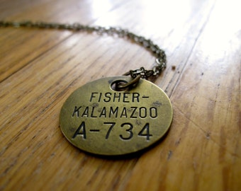 vintage fisher-kalamazoo tool check tag necklace