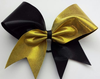 Black and gold cheer bow. Ask about bulk discounts, color and mascot options.