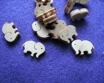 10 elephants, wood, 1 x 1.5 cm  (10-0011C)