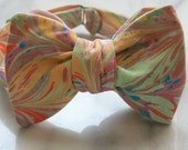 Brightly colored hand-sewn men's adjustable bow tie made with one-of-a-kind hand-dyed fabric.