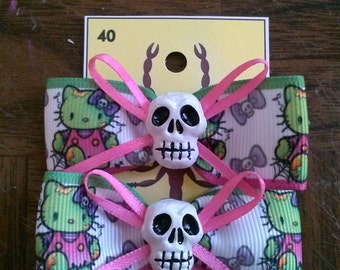 skull hello kitty barrettes