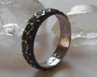 Sterling silver highly textured floral patterned band ring. Great for stacking with other rings or wear alone