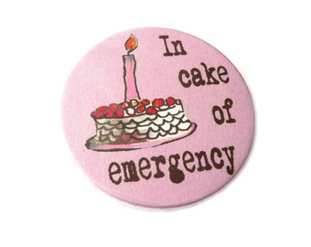 In cake of emergency,  pin, magnet, compact mirror or bottle opener