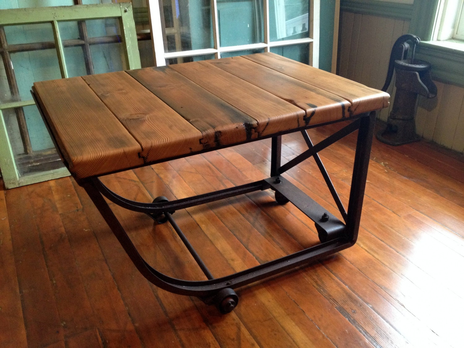 Reclaimed wood industrial coffee table metal casters barn for Repurposed metal furniture
