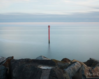 A marker in the sea off the West Bay pier, Dorset - Landscape photography - mounted print photograph 12 x 9