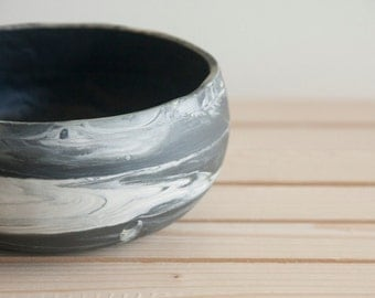 Marble black and white.Handmade ceramic bowl with black glossy glaze