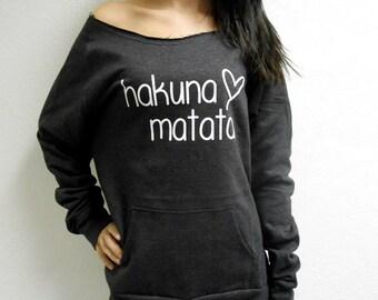 Hakuna Matata Off Shoulder Sweater. Raw Edge Off Shoulder Sweatshirt. Eco-Fleece Raw Edge Sweatshirt. Hakuna Mata Shirt. Fuzzy Sweatshirt.