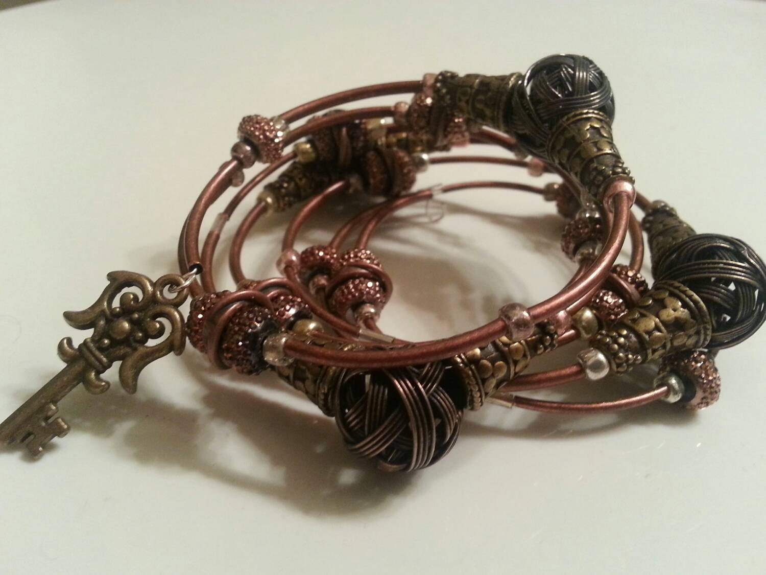 Copper and Bronze tone Steampunk Coil Wrap Metal Bracelet with Key charms steampunk buy now online
