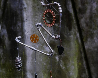Alien dreamcatcher Outer space totem Cosmic artifact