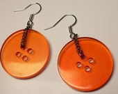Clear Orange Button Dangle Earrings! With silver earring hooks. Juicy! Yummy! Fun, stylish fashion. Funky summer passion
