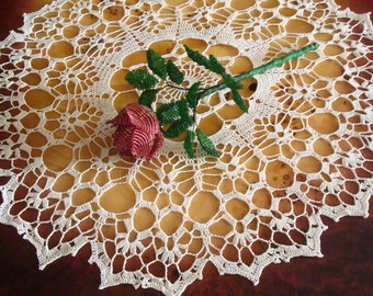 Openwork crocheted doily from high quality cotton