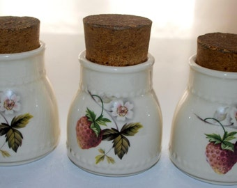Set of three ceramic canisters with corks
