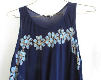 Vintage 1980s thin light sheer blue floral dress. Handkerchief cut hem.