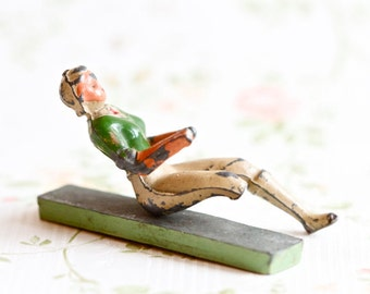 Antique Lead Toy - Sitting one legged Amazon with No Hands