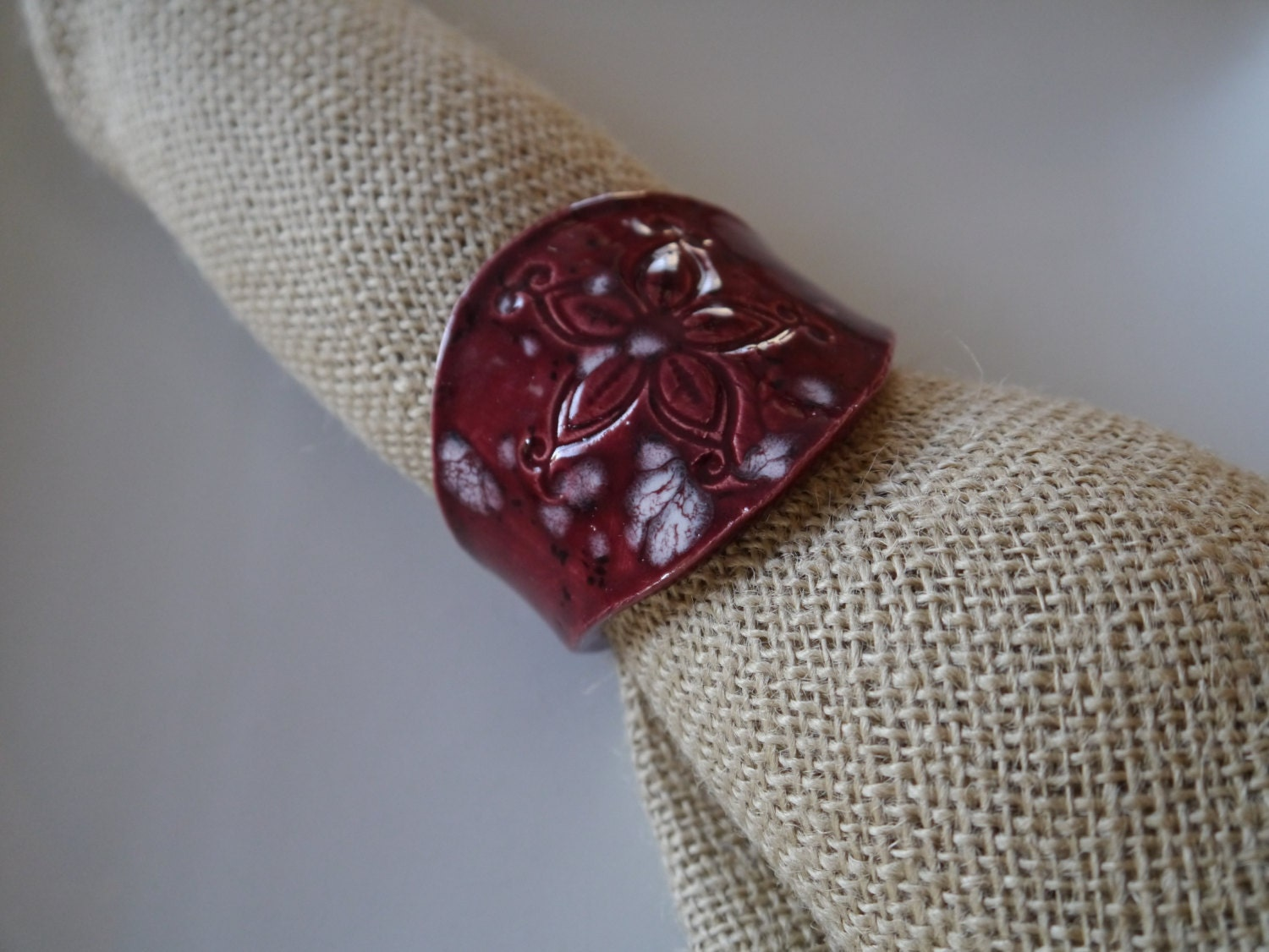 handmade unique napkin ring with sting by suburbanclayworks
