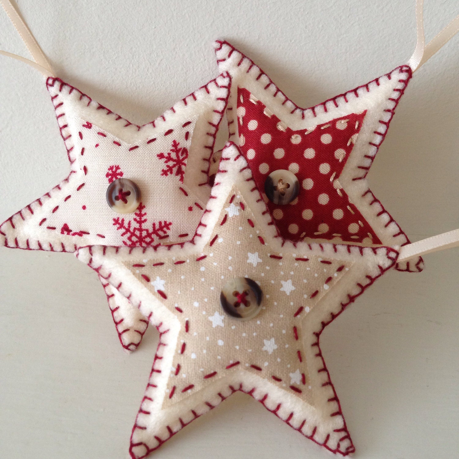 set of three star shaped felt christmas decorations handmade