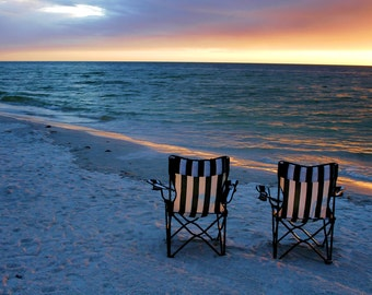 Beach Chairs on Sand at Sunset at the Ocean