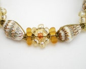 Micro macrame shell  bracelet with light yellow daisies  and dove shells on olive colored  nylon cord.