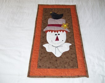 Scarecrows! This quilt is machine quilted and ready to hang! The mouth is hand embroidered. Good for wall or table.