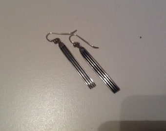 """Fabulous pair of Hopi earrings. Dangle silver bars with carved horizontal lines. 2 1/2"""" long."""