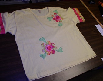 Ladies Yellow T-Shirt  by Anvil w/2 Multi Color Flowers with Lg  Button Centers/Green-White Check Hearts Appliqué by Emanuel's Wearable Art