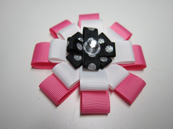 """Pink & Black Polkadot Hair Bow for the """"Glam"""" in Every Girl.  A three layered ribbon bow with metal clip on the back."""