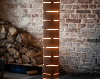 Floor lamp from bent plywood with natural wood texture