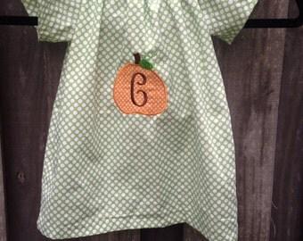Green polka dot monogram pumpkin dress