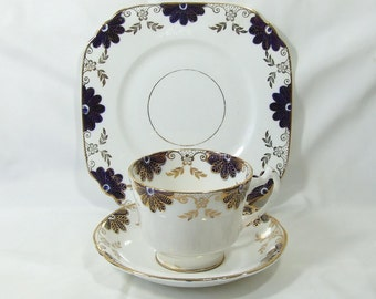 Art Deco   Fine bone china J.H.Cope &co  Wellington Trio  Cup and Saucer Blue and Gold decorated