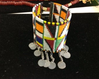 vintage african hand beaded cuff bracelet finished with metal disk