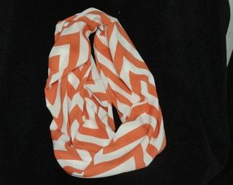A soft silky chevron salmon/dark peach and white infinity scarf
