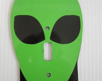 Light switch cover plate with alien design.