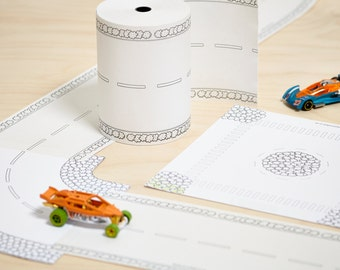 Paper Road On A Roll Ultimate Toy Car Track Kit. A 50m long, 11.5cm wide paper track for cars that you can make into any length and design.