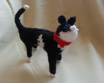 hand knitted black and white standing cat