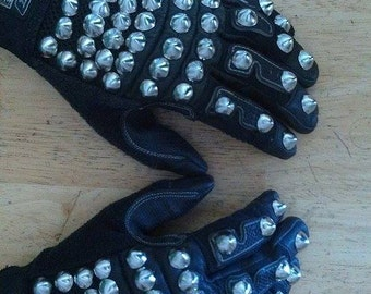 Studded, Gauntlet style gloves.