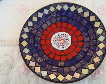 Bamboo bowl covered by millifiori in the centre surrounded by tiles and grouted all by hand.