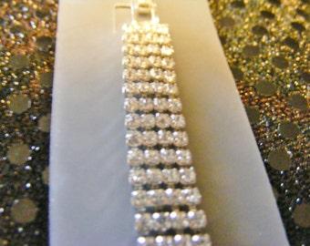 Artisan Collection four layered rhinestone bracelet