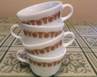 Four Pyrex cups