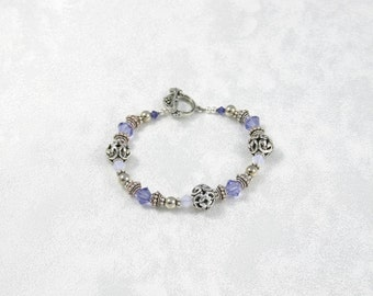 Tanzanite, violet opal and silver bracelet, with bead and scroll toggle clasp