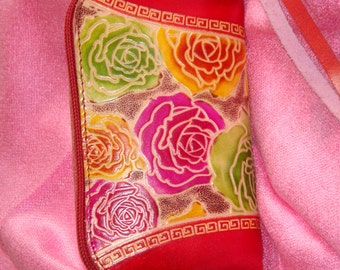 Genuine leather wristlet mini purse. Colorful Flowers embossed on both side, a Joyful pattern. Truly Handmade and rectangle shaped.