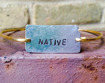 "Kansas Hand Stamped ""NATIVE"" Bangle in 2 tone reverse- this item is pre stamped and has limited quantities."