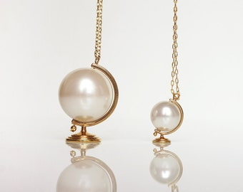 It's a Small World After All - Mini Globe Pearl Necklace - Brass Edition by TO+WN DESIGN , a popular graduation gift