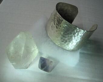 Wide, sterling silver cuff bracelet.