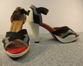 New. Comfortview. Size 7 1/2.  Opened toed 4  inch high heels.  Black, white, gray and red.