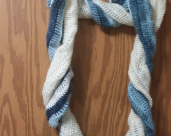Ruffle blue and white scarf  hand wash lay flat to dry.  Very pretty and fashionable.