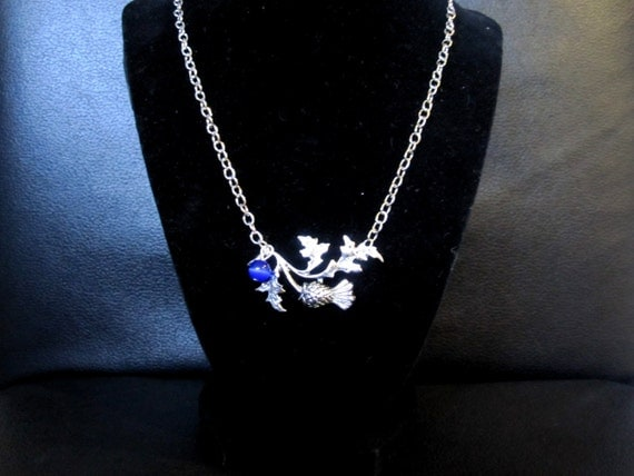 Antique silver Scottish thistle necklace with cobalt blue tiger eye bead accent
